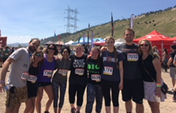 NEHA staff posing together after toughing it out at the 2018 Rugged Maniac event