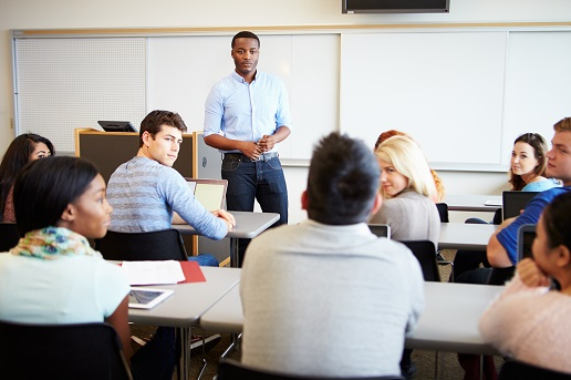 College students in classroom with instructor